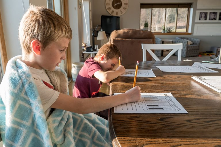 boys at kitchen table homeschooling